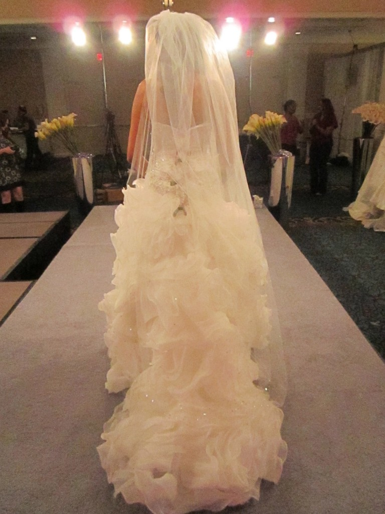 Because Melea's gown was already so dramatic, I chose a simple cathedral-length veil by Malis Henderson.