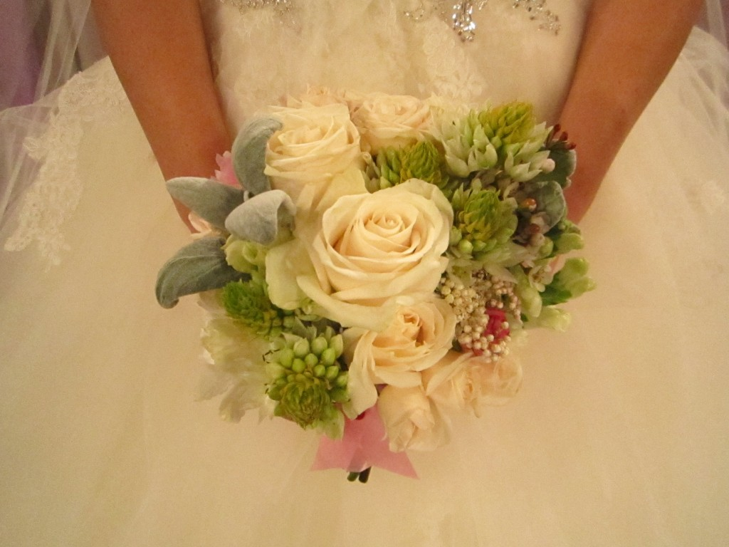 Sarah's bouquet of creams and light green succulents coordinated with the color scheme of her wedding.