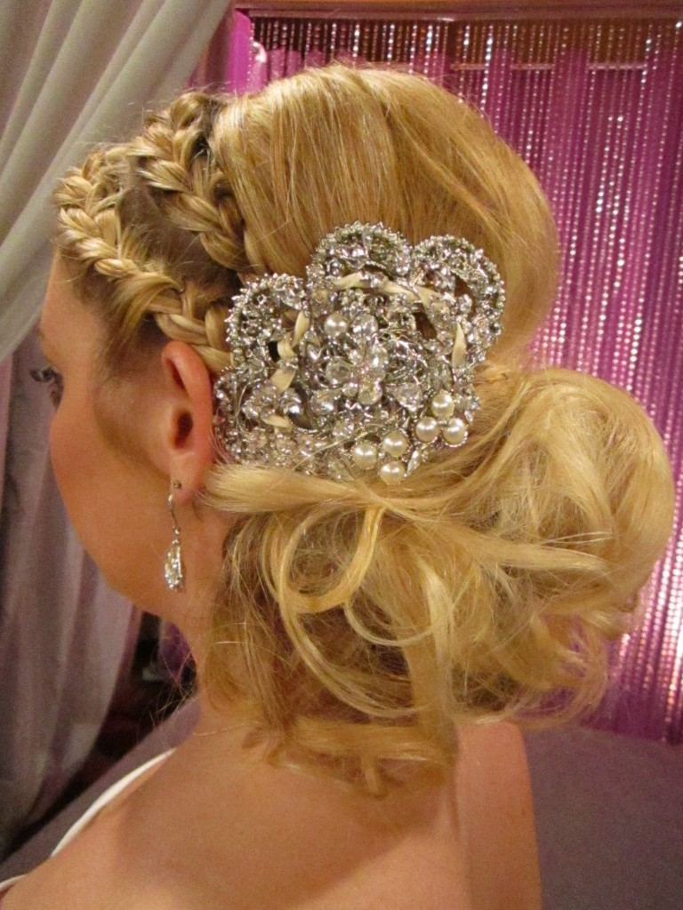 Lindsay created a playful, modern, and sophisticated up-do by combining braids fitting close to Samantha's head and loose curls in the back.  Her look was complete with the addition of sparkling hair jewelry by Maria Elena.