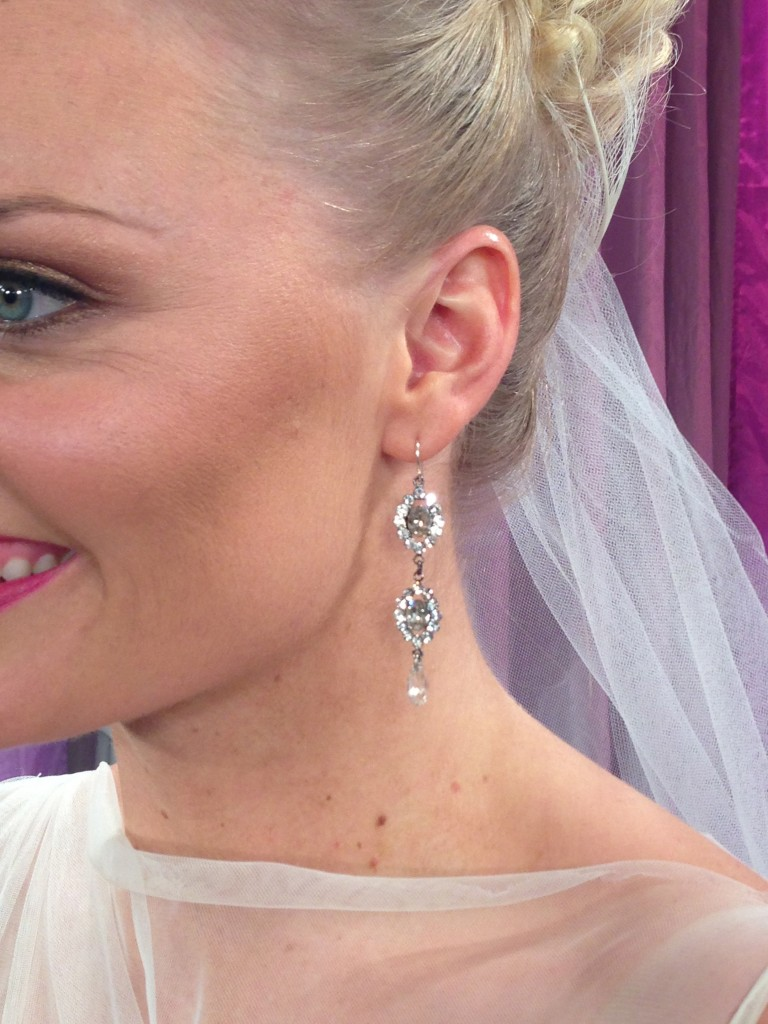 Tiered crystal earrings by Thomas Knoell for Watters Bride added sparkle and movement.